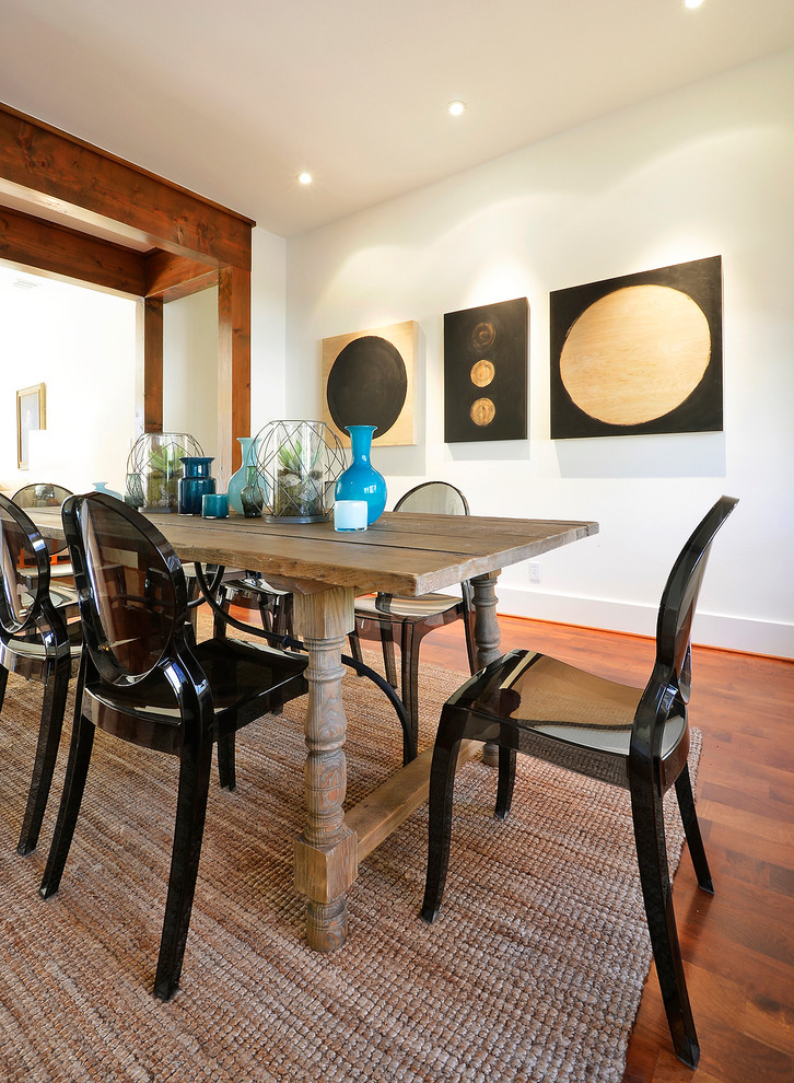 farmhouse tables black glass cahirs traditional area rug wooden floor white walls black and beige artworks recessed lighting
