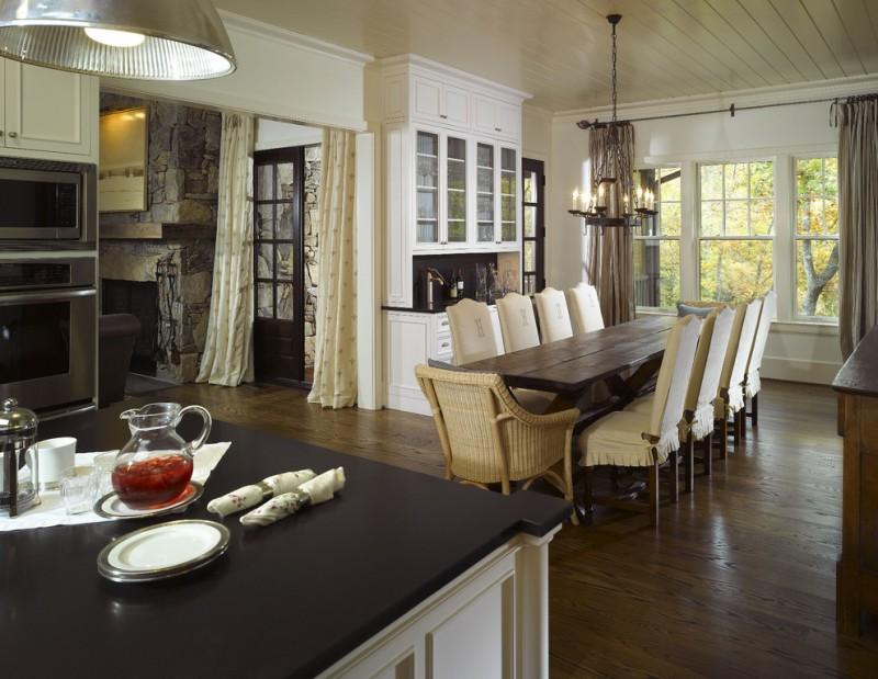 farmhouse tables farmhouse chandelier wooden floor rattan armchairs beige chairs white cabinet glass windows brown curtains
