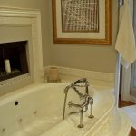 Fireplace Candle Ideas Built In Tub Artwork Tub Filler Whte Mantel Towel Holder Wooden Floor Grey Walls White Bathroom Mat