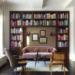 Home Library With Big Wooden Bookcase, Purple Sofa, Chairs, Rug