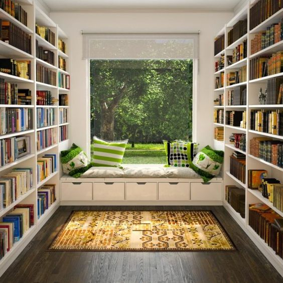 home library with white wooden bookcase, white bench with cushion, pillows, rug,