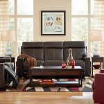 Living Room With Recliners Wooden Coffee Table With Drawers Colorful Birds Artwork Side Tables Colorful Area Rug Table Lamps Window Curtains