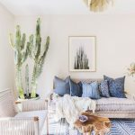Living Room With White Wall, White Bench, White Sofa, Woden Coffee Table, Plants, White Blue Rug
