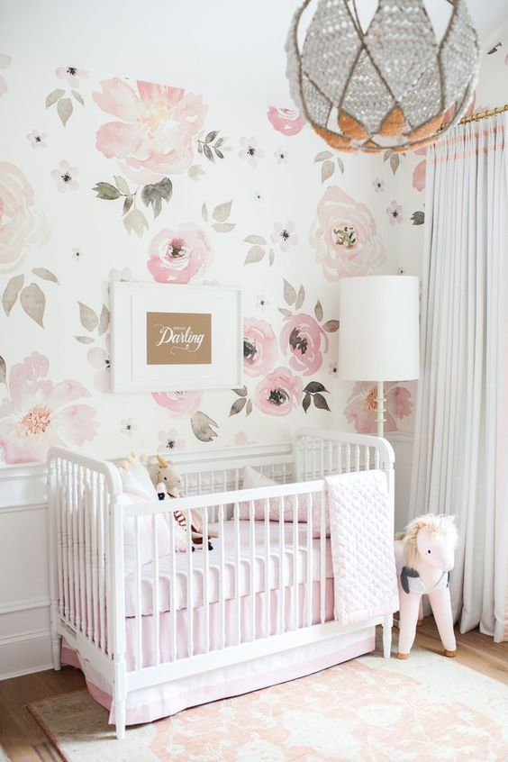 nursery with flowery wallpaper, wooden floor, pink rug, stuffed horse, white box, white floor lamp