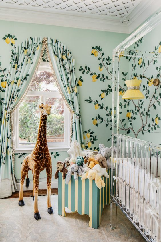 nursery with green wall, flower wall sticker, matching sticker, white wooden window, clear plastic baby box, green toy box