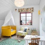 Nursery With White Walls, White Wooden Floor, White Slanted Ceiling, White Table, Brown Wooden Chair, Whtie Yellow Sofa, Yellow Baby Box