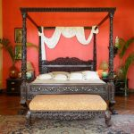 Queen Size Canopy Bed Sets Antique Design Bed Nightstands Table Lamps Patterned Area Rug Bench Window Rattan Shade Wooden Floor