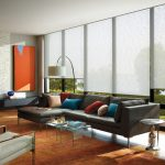 Roll Up Window Shade Floor Lamp Grey Sectional Sofa Colorful Throw Pillows Area Rug Glass Cocktail Tables Fireplace Armchair Side Table