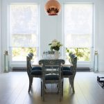 Roll Up Window Shade Pendant Lamp Glass Windows Antique Patterned Dining Chairs With Blue Cushions Dining Table Wooden Floor White Flower Vase