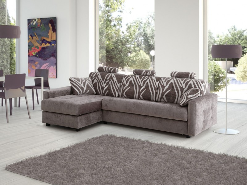 sectional sleeper sofa queen patterned back grey shag area rug textured flooring colorful artwork glass windows white table