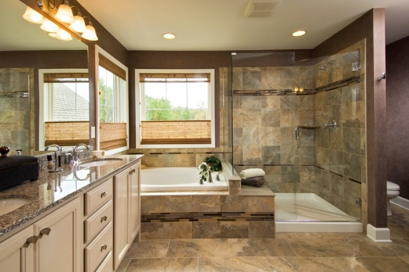 solid shower base window built in tug bamboo shade stone floor and wall tiles glass shower door bege vanity granite top sinks mirror sconces