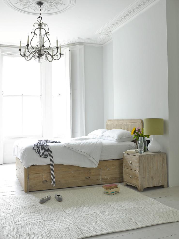 underbed storage solutions chandelier textured rug wooden bed wooden nightstand table lamp wooden headboard white bedding