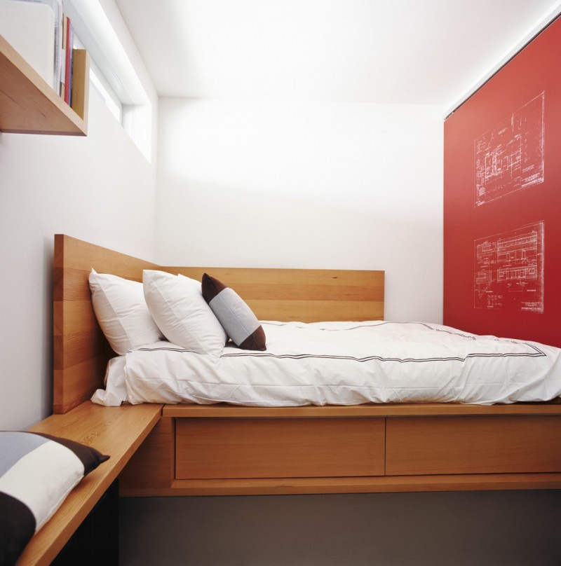 underbed storage solutions white bedding white pillows red accent walls brown carpet wall mounted wooden shelves window