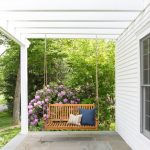 Wooden Hanging Sofa With Pillows In Grey Porch