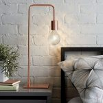A Bedside Lamp With Tall Pillar In Bronze, Facet Ish Bulb