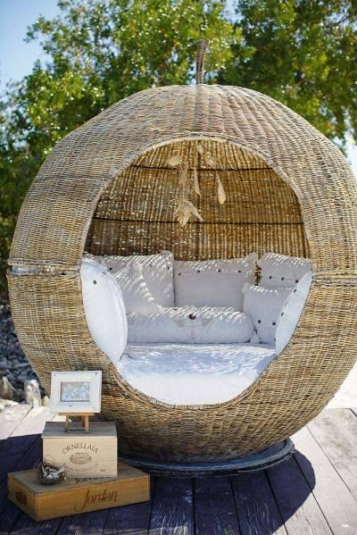 a round ball outdoor sofa bed protected of woven rattan