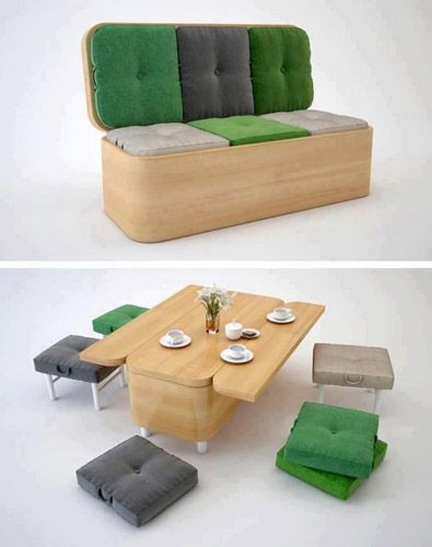 a simple bench with green and grey cushions opened as dinner set