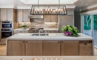 backsplash texture altar pendant lamp white countertops wooden island wooden cabinets built in appliances sink stovetop rangehood glass doors