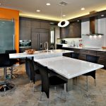 Backsplash Texture Dark Brown Cainets White Marble Island White Countertops Black Barstools Black Chairs Stovetop Sink Built In Appliances Granite Floor Tile Pendant Lamp