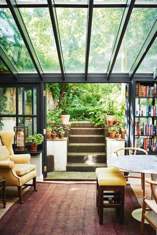 basement with chairs, sofa, table, glass ceiling, entrance to the garden
