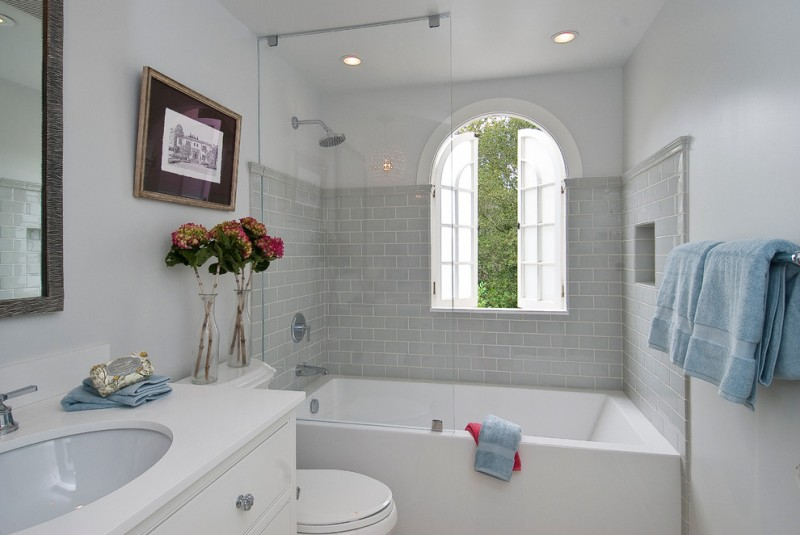 bathtub cartridge arched window glass shower door built in tub grey wall tile wall mirror towel holder white vanity sink white top