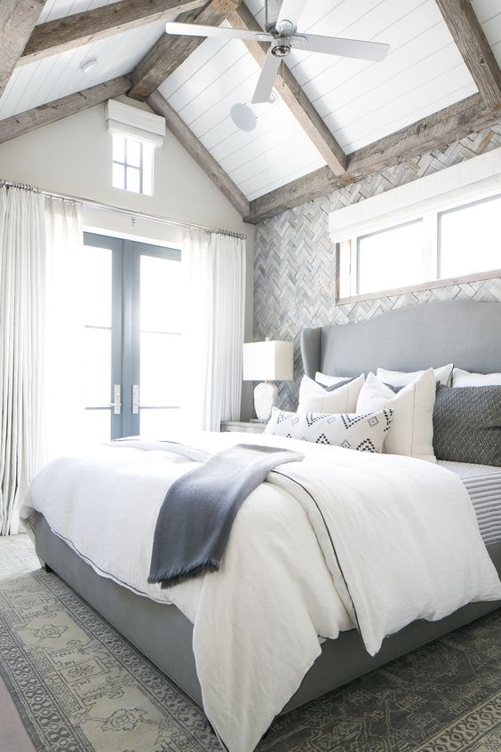 bedroom with rug, grey bedding with white linen, grey wall, white curtain, white wooden ceiling, wooden bord, vaulted ceiling, van