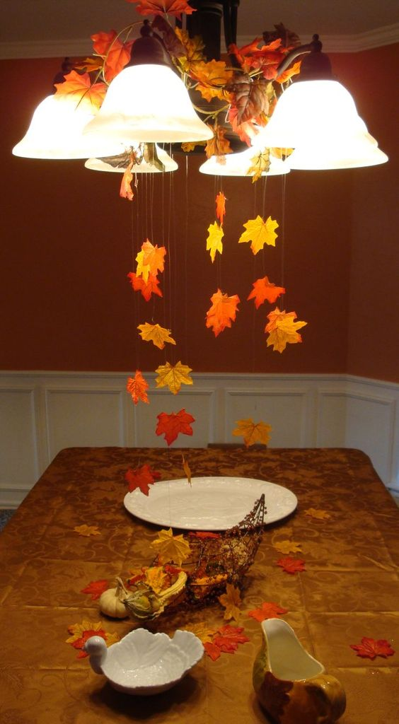 brown wooden table with accessories, maple leaves, plates