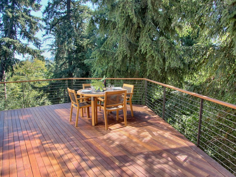 cable railing deck wooden deck flooring wooden railing cap steel calble railing oval wooden glass table wooden chairs
