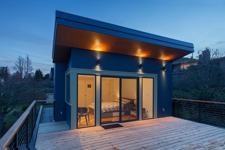 cable railing deck wooden railing cap wooden outdoor flooring glass windows glass doors bedroom chair wall sconces