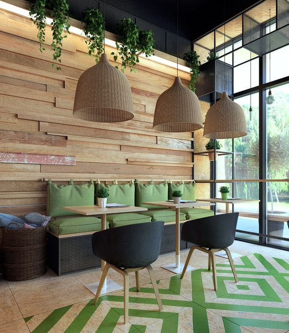 cafe with beige floor ombined with green tiles makes diamond shapes