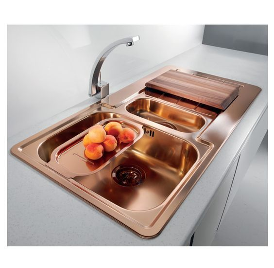 copper sink with two basins, cutting board, tray