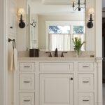 Craftsman Style Wall Sconce Wall Mirror White Vanity Old Bronze Faucet Towel Ring Beige Floor Tile Beige Top Sink