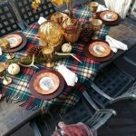 Dining Table With Plaid Tablecloth, Brown Plates With Elephant Picture, Maple Leaves, Pines, Golden Goblet