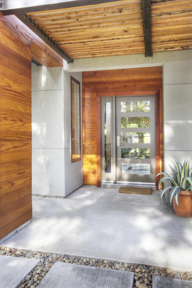 entry door with one sidelight grey door five glass panels grey framed sidelight wooden walls window concrete flooring outdoor mat