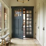 Entry Door With One Sidelight Paneled Glass Sidelight Antique Pendant Lamp Traditional Rug Small Bench Beige Walls Windows