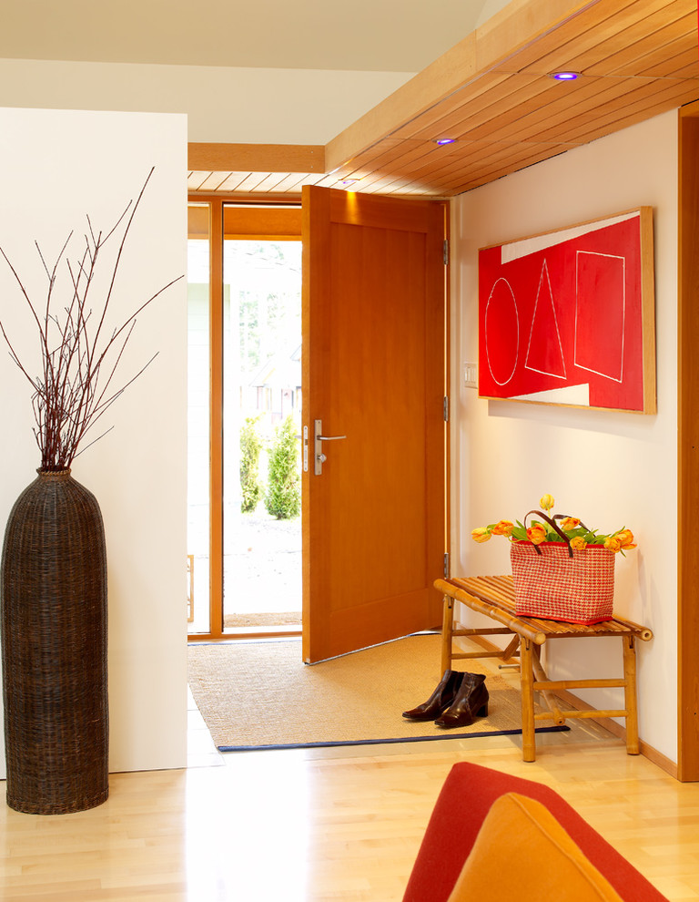 entry door with one sidelight red artwork entryway bamboo bench brown area rug wooden floor traditional vase wood ceiling recessed light