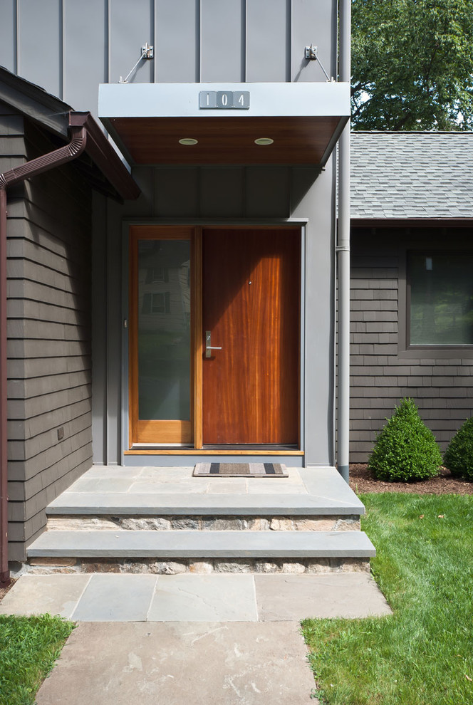 entry door with one sidelight roof grass plants outdoor mat entry steps recessed lighting wooden door grey wall