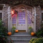 Front Porch With White Wooden Door, Pumpkins, Spiders, Sconces, Spider Web