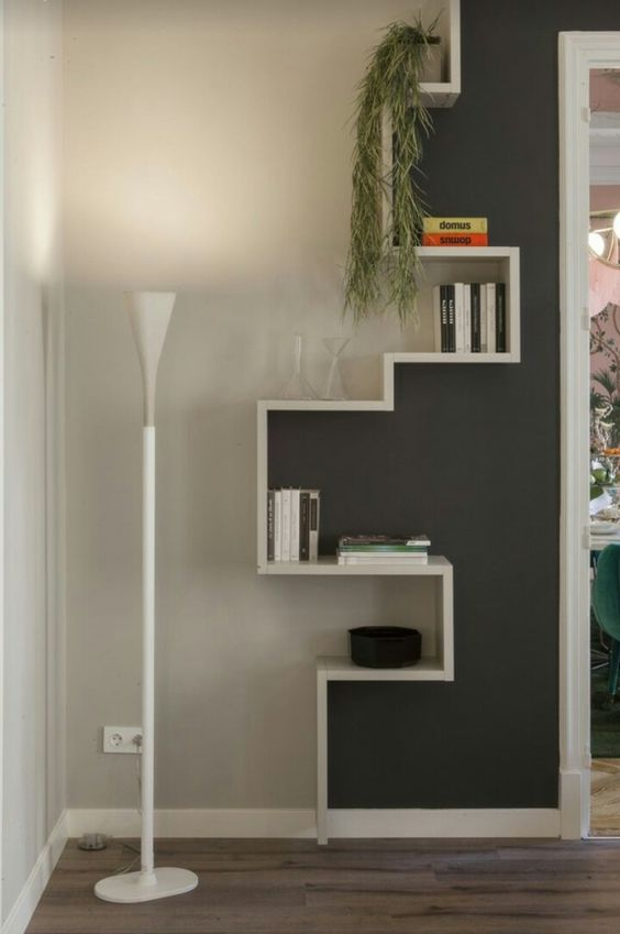 grey and white wall with wooden shelves on line on the wall