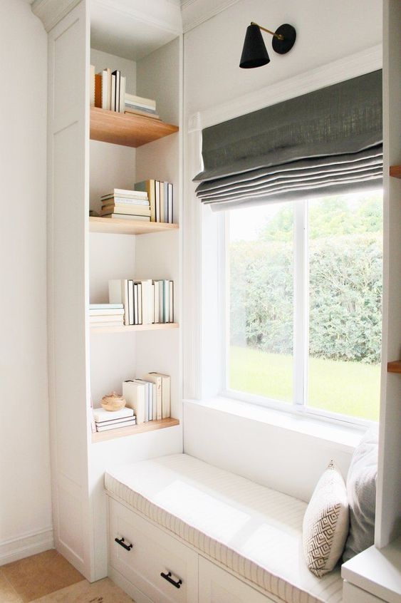 grey basic roman shades on white wooden framed windows