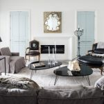 Living Room Chair Slipcovers Black Nesting Tables Wall Mirror Fireplace Grey Sofa Black Leathered Chairs And Stool Table Lamp Black Side Table Rug Pillows