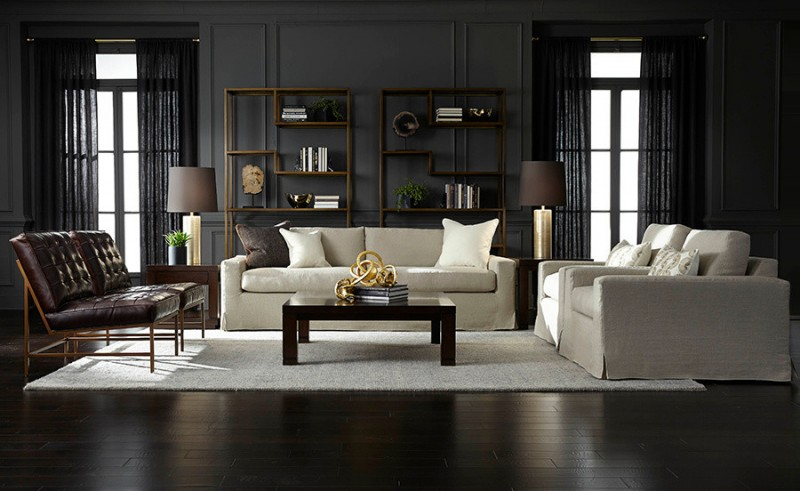 living room chair slipcovers wooden coffee table wooden side tables leathered tufted chairs table lamps pillows wooden rack grey walls black curtains white rug
