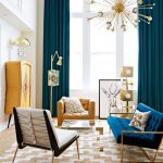 Living Room With Brown Rug, Yellow And Blue Sofa, White Chair, Golden Floor Lamps, Golden Chandelier, Yellow Cabinet, Turquiose Curtain,
