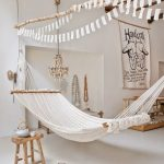 Living Room With White Floor, White Walls, Open Wood Ceiling, Bohemian Style, Woven Hammock