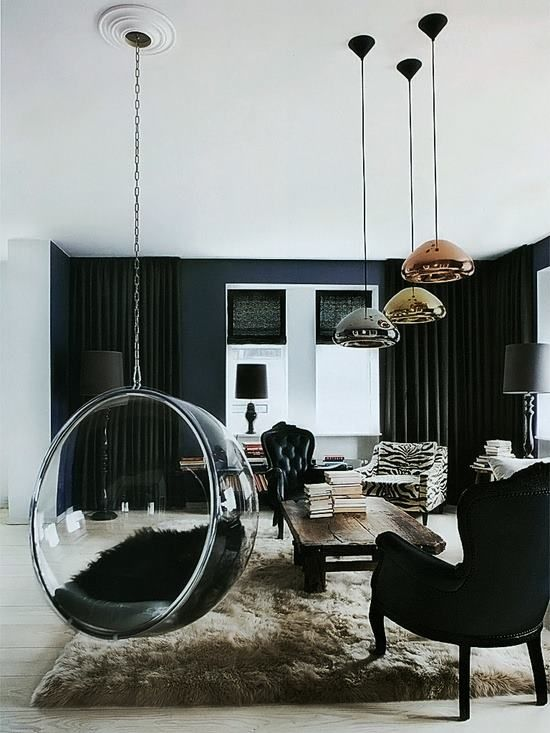 living room with wooden floor, black velvet chairs, wooden table, molten like lamps, black curtain, clear swing