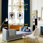 Living Room With Yellow Stone Floor, Light Blue Sofa, White Chair, White Floor Lamp, Yellow Cabinet, Blue Curtain, White Wall, Chandelier