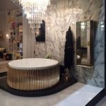 Luxury Bathroom With Marbles, Golden Tub, Crysta Lchandelier, Mirror