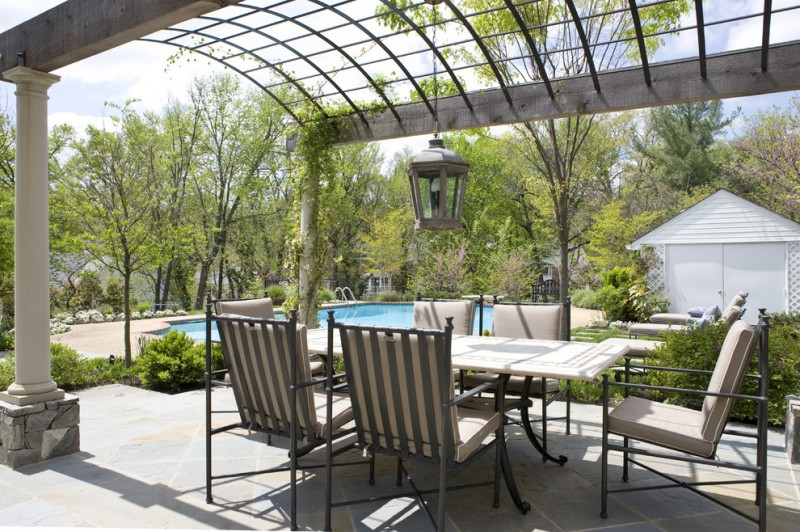 metal patio dining chairs tan chairs cushions traditional pendant lamp metal roof pillars grey paved floor pool wooden table with metal legs
