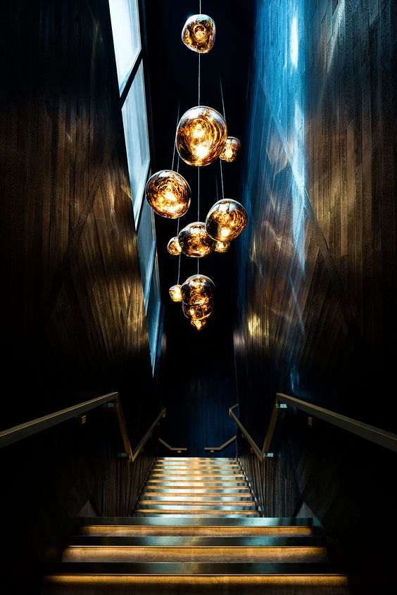 pendants with shapes like molten gold in the middle of the stairs