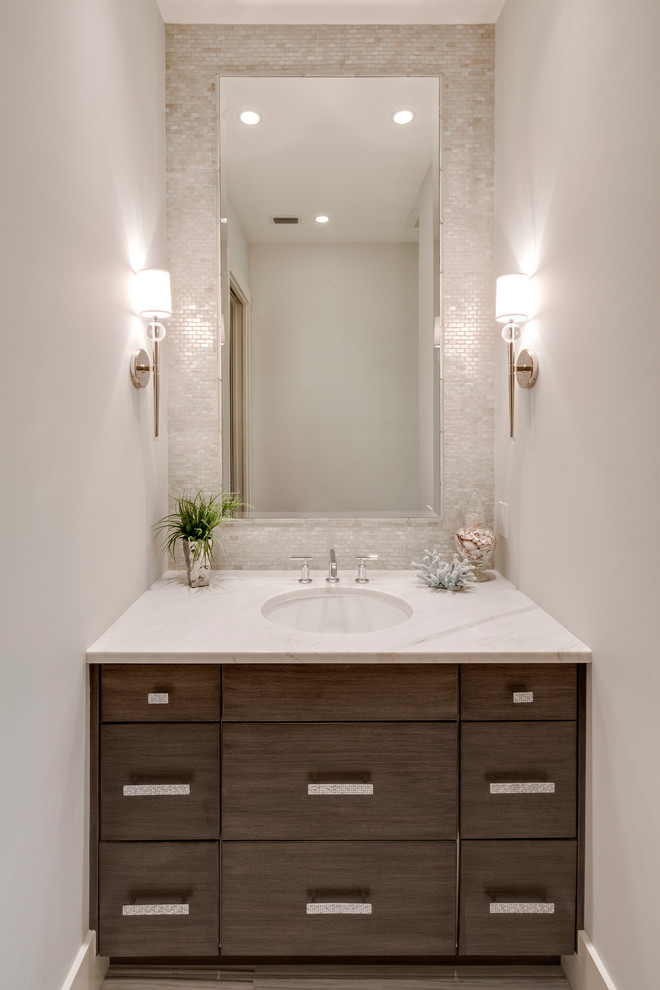 polished nickel mirror wall sconces white mosaic wall tile round undermount sink chrome faucet white marble countertop wooden vanity
